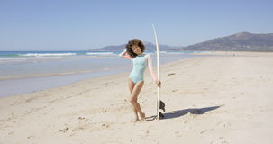 Female posing on beach with surfboard Royalty Free Stock Images