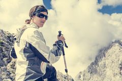 Female posing in front of a cloudy peaks Stock Photos