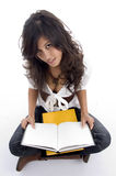 Female posing with her opened books. With white background Royalty Free Stock Image