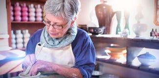 Female potter making pot royalty free stock photos
