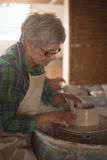Female potter making a pot Stock Photos