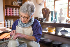 Female potter making pot Royalty Free Stock Photos
