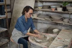 Female potter molding a clay Stock Images