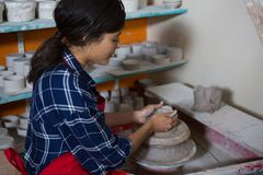 Female potter molding a clay Royalty Free Stock Photo