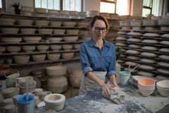 Female potter molding a clay Stock Photo