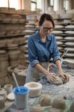 Female potter molding a clay Stock Image