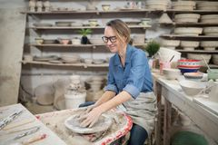 Female potter molding a clay Stock Photography