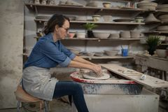 Female potter molding clay Royalty Free Stock Images