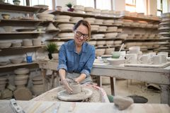 Female potter molding a clay Royalty Free Stock Photography