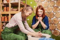 Feminine potter teaches royalty free stock images