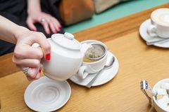 Pouring tea table Stock Photography