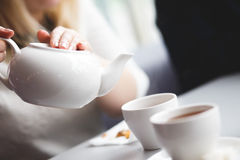 Female pouring tea royalty free stock photo