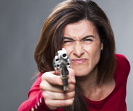 Female power concept for near-sighted brunette shooting Stock Photos