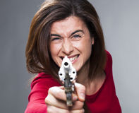 Female power concept for scared 30s brunette shooting Royalty Free Stock Photos