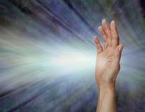 Female Pranic healer sending focused energy from right hand palm chakra