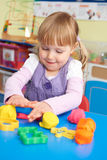 Female Pre School Pupil Playing With Modelling Clay stock photo