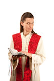 Female preacher. With Bible and holy garments royalty free stock photography