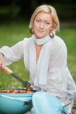 Female Preparing Food On Barbecue Stock Images