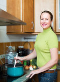Female preparing meal at home Stock Photography