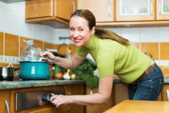 Female preparing meal at home Stock Image
