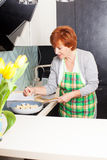Female preparing pasta with cheese Stock Photo