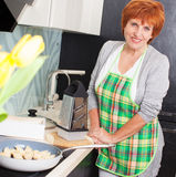 Female preparing pasta with cheese Stock Images