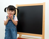 Female preschooler with apple in hand Royalty Free Stock Photos