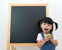 Female preschooler with apple in hand Stock Photo