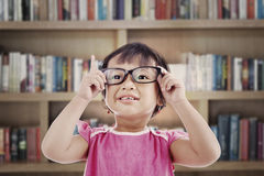 Female preschooler in library Stock Photo