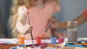 Female preschoolers painting a picture at art club, hobby and leisure activities stock footage