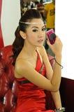 Female presenter of Canon booth Stock Photos