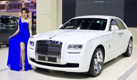 Female Presenter With Rolls Royce Car. Royalty Free Stock Photo