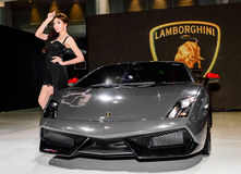 Female presenters model at the Lamborghini booth during. BANGKOK - JUNE 20 : Female presenters model at the Lamborghini booth during at Bangkok International Royalty Free Stock Photography