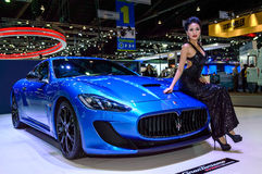 Female presenters model with MaseratiGranTurismo MC Stradale Stock Photo