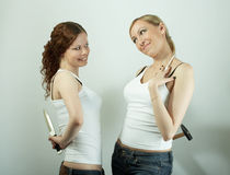 Female pretence. Two hypocritical girls smile each other at a meeting Stock Photos