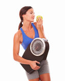 Female pretty adult dieting on fruits Royalty Free Stock Photos