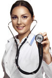 Female pretty doctor with a stethoscope listening Stock Photos