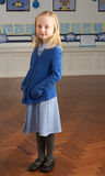 Female Primary School Pupil Standing In Classroom stock photo