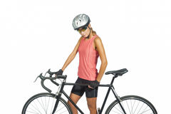 Female professional cycling athlete posing with    racing bike.m. Odel equipped with professional sport gear, isolated over white background. horizontal shot Royalty Free Stock Image