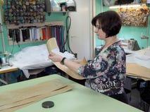 Woman fashion designer works in the Atelier stock photos
