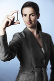 Female professional holding key between fingers Royalty Free Stock Images