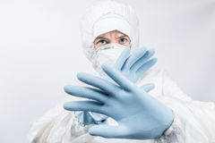 Female professional in hooded suit for bio-hazard protection Stock Photo