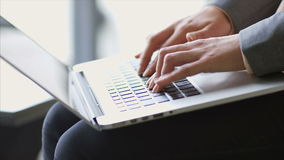 Female professional's hands typing on laptop keypad in office. Cropped video of female professional's hands typing on laptop keypad. Tilt up shot of stock video