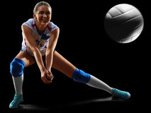 Female professional volleyball player on black. Background stock photos