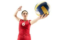Female professional volleyball player isolated on white. With ball. The athlete, exercise, action, sport, healthy lifestyle, training, fitness concept stock images