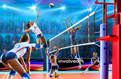 Female professional volleyball players in action on grand court Royalty Free Stock Image