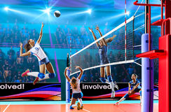 Female professional volleyball players in action on grand court. Female professional volleyball players on grand court in hilights Royalty Free Stock Photo