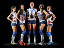 Female professional volleyball players on black. Background royalty free stock images