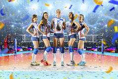 Female professional volleyball players in action on grand court. Female professional volleyball players on grand court in hilights stock image