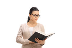 Female professor reading a book Royalty Free Stock Images